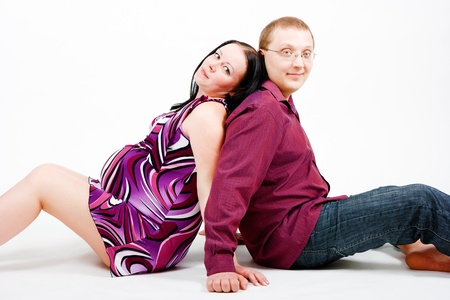 beautiful womb: Young couple - A pregnant woman in a dress and a man