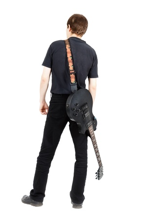 a guitarist boy playing guitar: A young man with a black electric guitar isolated on white background