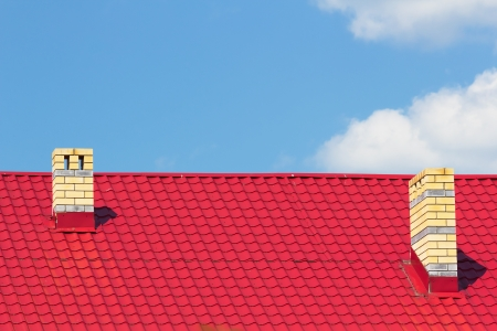 Red roof with chimneys against the sky photo