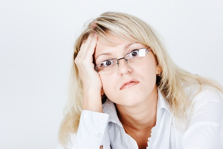frazzled: Tired of attractive young blond woman in glasses. portrait
