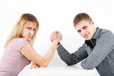 Woman struggling with a man. family armwrestling photo