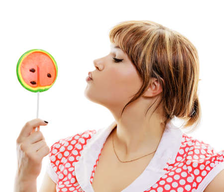 attractive girl with a round lollipop on a white background Stock Photo - 23136187