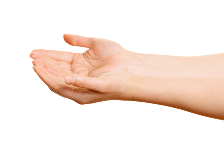 cupped hands: Womans hands holding something on a white background Stock Photo