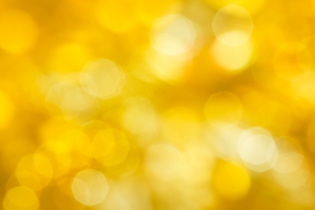 Golden festive abstraction. Defocus highlights. yellow background photo