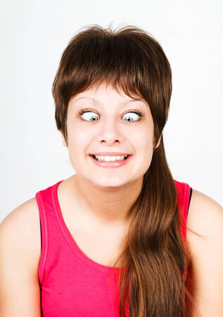cross eyed squinting expression young girl. portrait photo