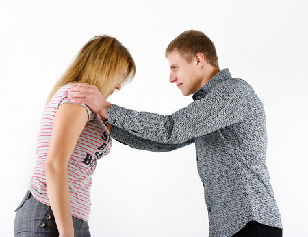 young woman fighting with a man. family quarrel photo