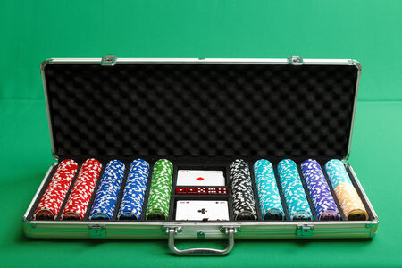 suitcase for poker with chips and cards photo