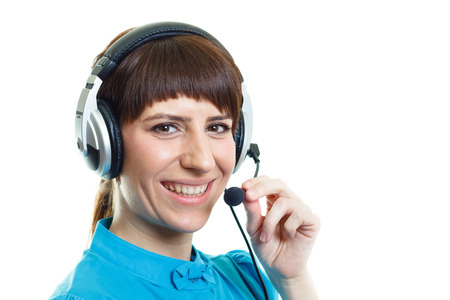 Smiling confident attractive girl with headphones microphone on white background photo