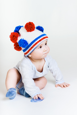 cute baby in a funny knitted hat