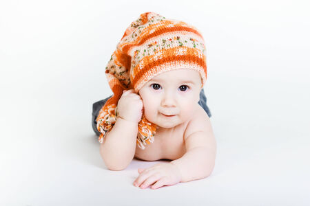 Little baby boy in a knitted hat posing photo