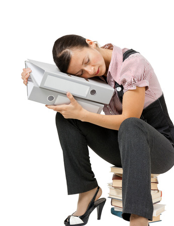 Young woman sleeping on the books. Tired office worker photo