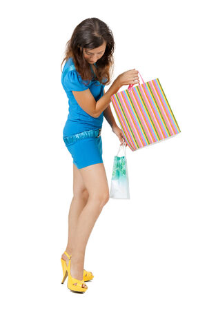 Young woman in a bright beautiful clothes shopping photo
