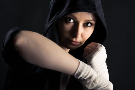 On a black background girl with a fighting stance