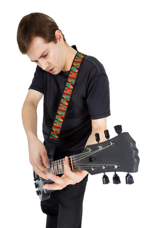 Young man with electric guitar isolated on white background. Performer of rock music photo
