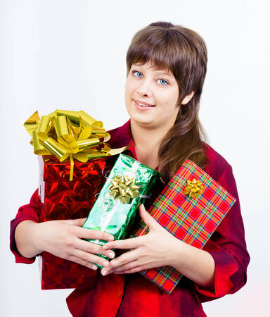 Young beautiful girl with a gift box photo