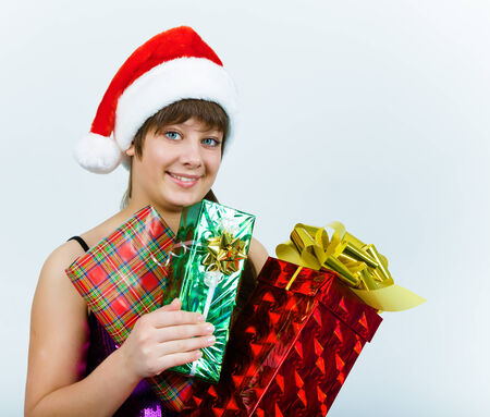 Attractive young woman in santa hat with gift box photo