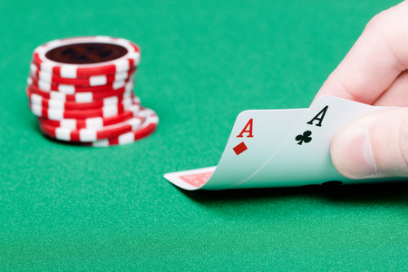 card player: card player. Male hand with cards and chips close-up Stock Photo