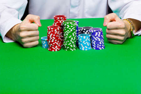 Man with a bunch of chips. Green casino table photo