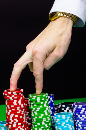 Mans hand and stairs of the chips. step Forward photo