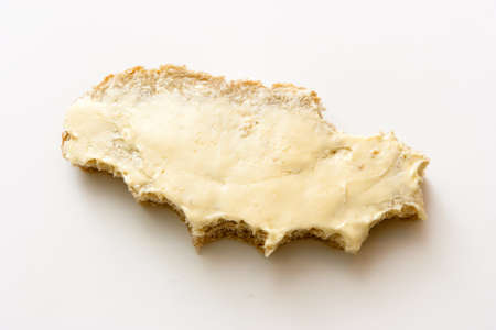 snapped: Bitten off a sandwich. Bread and butter on a light background