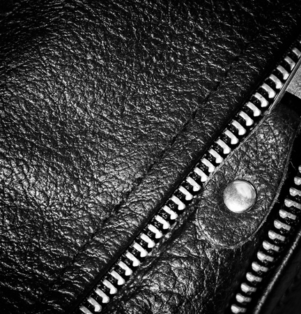 Part black leather clothing with a zipper. macro photo photo