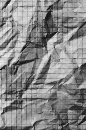 Part of the surface crumpled checkered paper. macro photo photo