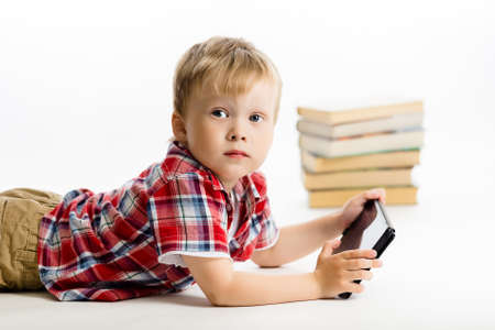 Little boy with a Tablet PC. studio photo