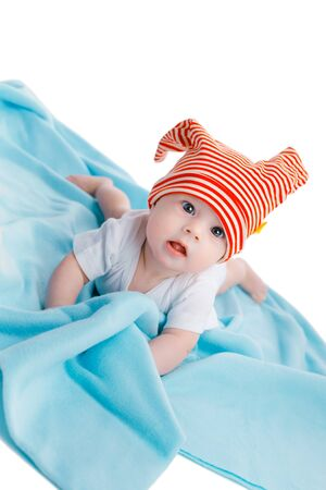 blue blanket: baby in a striped hat on a blue blanket