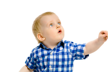 looking at baby: baby boy looking up on a white background