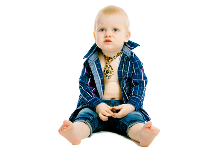 shirt and tie: Little dissatisfied boy in a plaid shirt, tie and jeans on a white background
