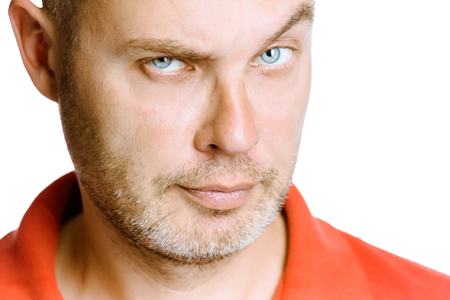 strict: strict unshaven man on a white background. face close up Stock Photo