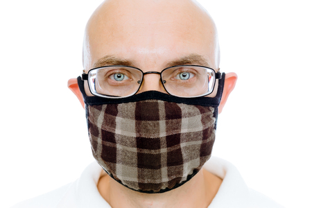 white mask: Bald man on a white background in the fashion warm medical mask Stock Photo