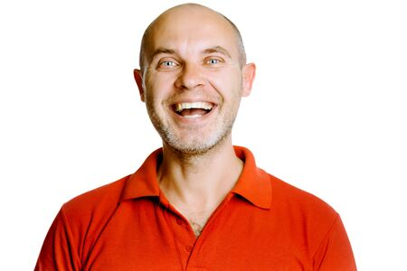 unshaven: Unshaven laughing blue eyes middle-aged man in a red T-shirt. Studio. isolated Stock Photo