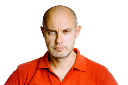 unshaven: Unshaven fearsome blue eyes middle-aged man in a red T-shirt. Studio. isolated