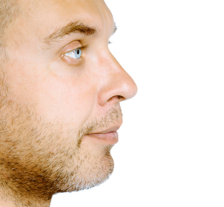 unshaven: Unshaven blue eyed middle-aged man in profile. Studio. isolated