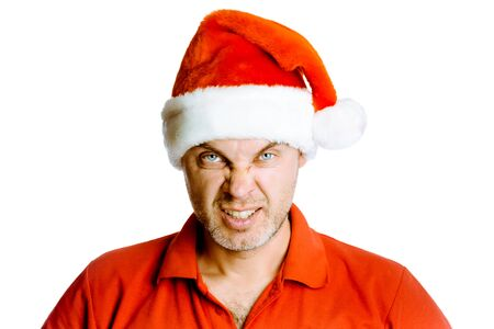 unshaven: Unshaven blue eyes angry man in a red shirt and Santa hats. Studio. isolated
