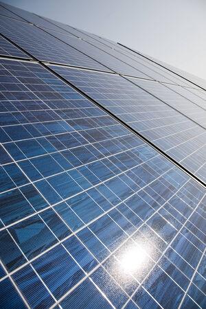 powerplant: Solar power plant panels with sun reflection. Stock Photo