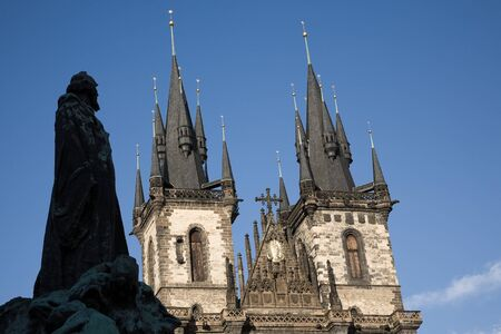 old town square: St. Teyn gothic cathedral on Old Town Square with silhouette of Jan Hus statue. Prague, Czech Republic, Europe. Stock Photo