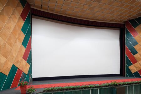 projection screen: PR (property release) available. Empty cinema auditorium with line of chairs and projection screen. Ready for adding your own picture. Side view.