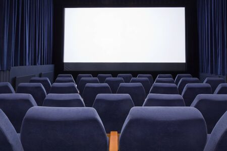 projection screen: PR (property release) available. Empty cinema auditorium with line of chairs and projection screen. Ready for adding your own picture. Front view.