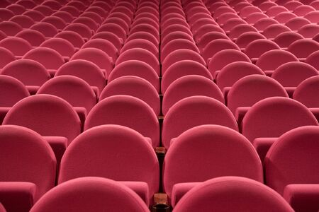 PR (property release) available. Empty cinema auditorium with line of chairs. Front view. photo