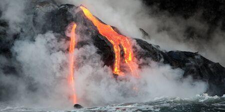 volcano: Hot lava stream is flowing into the ocean. Hawaii, Big Island. Stock Photo