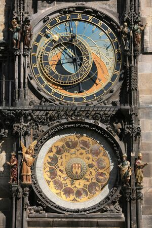 manes: Unique clock on gothic tower supplemented with a round calendarium including the signs of the zodiac painted by Josef Manes (1865). Stock Photo