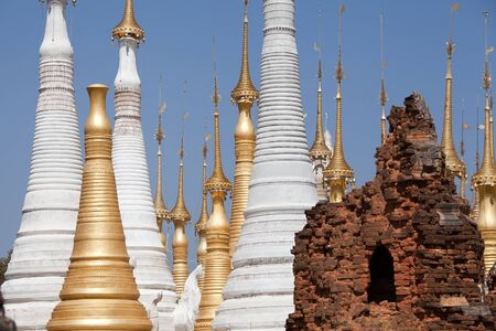 reconstructed: Shwe Inn Thein Paya, Indein, Burma. Weather-beaten buddhistic zedi constructed in 17th and 18th century damaged by earthquake in 1975, partitialy back reconstructed.