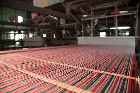 weavers: Hand loom in weaving workshop in Burma. Stock Photo