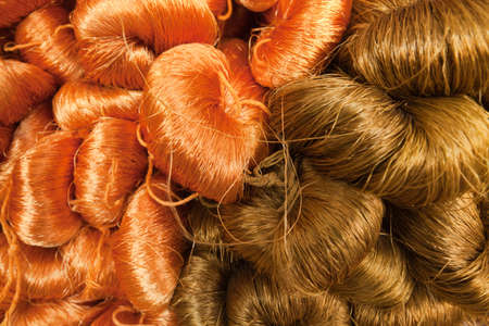 gingery: Close-up of yarn colored by nature colors ready for sale. Stock Photo