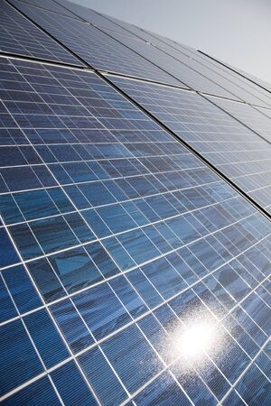 solar power plant: Solar power plant panels with sun reflection. Stock Photo