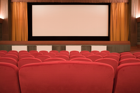 PR (property release) available. Empty retro cinema auditorium in cubism style with line of chairs and projection screen. Ready for adding your own picture. Standard-Bild