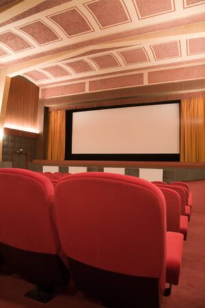projection screen: PR (property release) available. Empty retro cinema auditorium in cubism style with line of chairs and projection screen. Ready for adding your own picture. Stock Photo