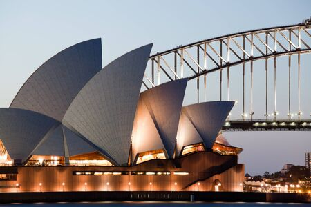 utzon: SYDNEY - FEBRUARY 6, 2013: The Sydney Opera House with Harbor bridge in Sydney, Australia on February 6, 2013. Designed by Danish architect Jorn Utzon; this year is celebrating the 40th opening anniversary